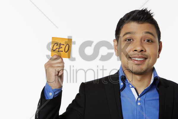 businessman holding up adhesive note stock photo