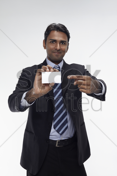 businessman holding up his business card stock photo