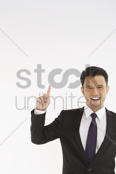 businessman holding up index finger stock photo