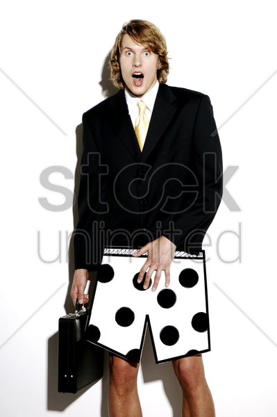 businessman in boxer shorts showing shocked expression stock photo