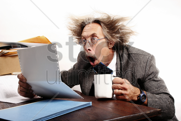 businessman in shock after reading the sales report stock photo
