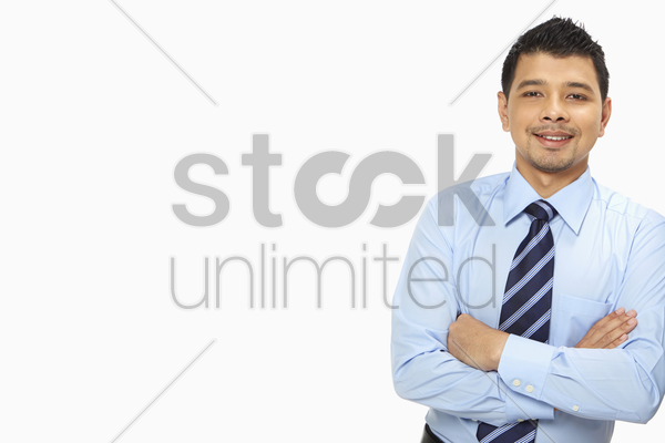 businessman leaning against a wall stock photo