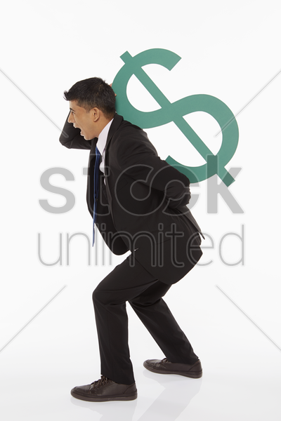 businessman lifting up a dollar sign stock photo