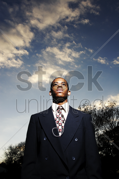 businessman listening to music on the earphones stock photo