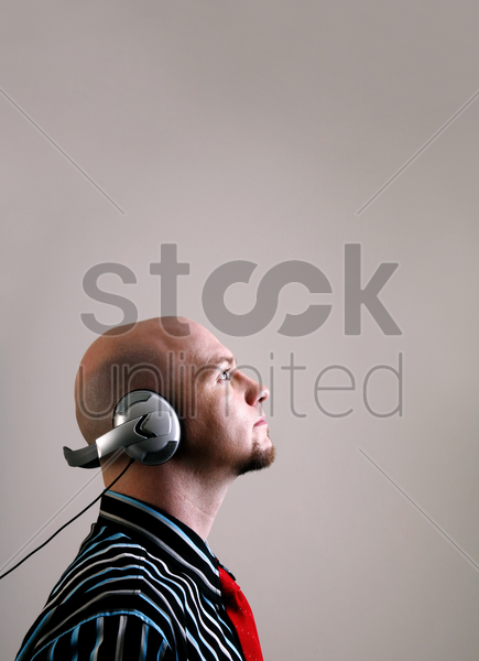 businessman listening to music on the headphones stock photo