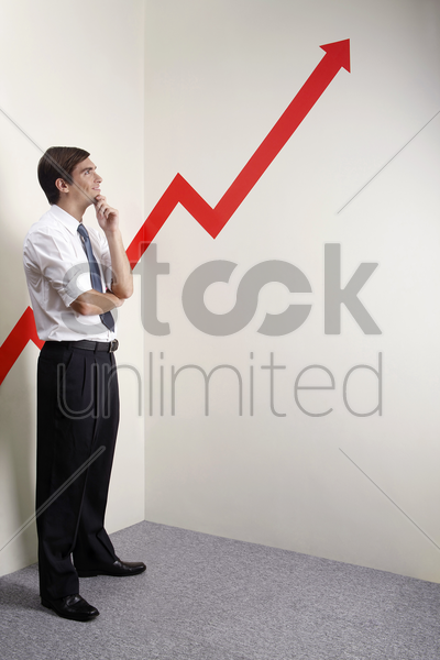 businessman looking at a rocketing arrow sign stock photo