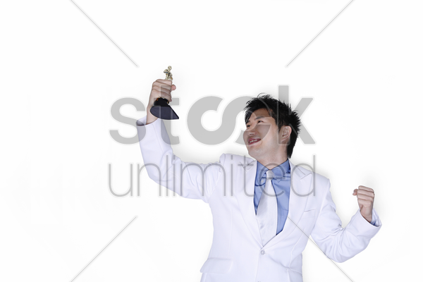 businessman looking at his award with joy stock photo