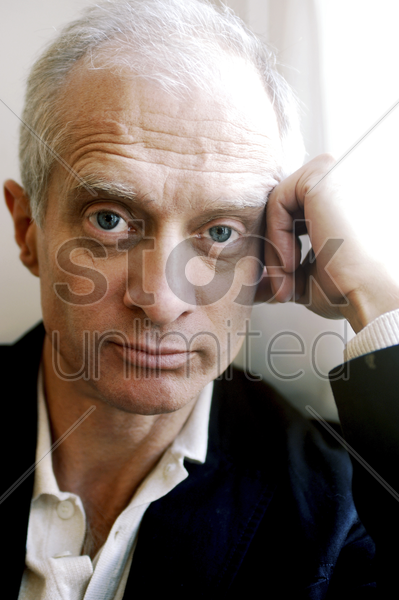 businessman looking at the camera stock photo