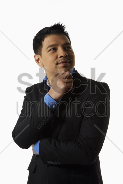 businessman looking away and thinking stock photo