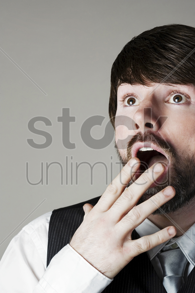 businessman looking up in disbelief stock photo