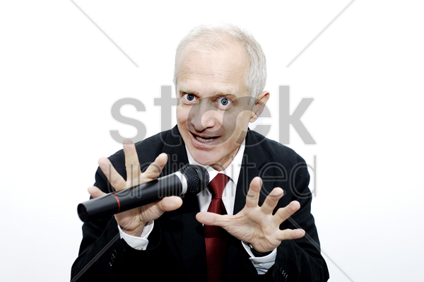 businessman making a funny expression while singing stock photo