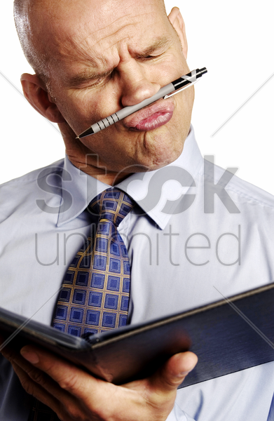 businessman making funny facial expression while reading document stock photo