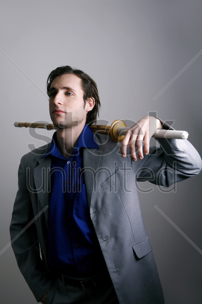 businessman placing shinai on the back of his shoulder stock photo