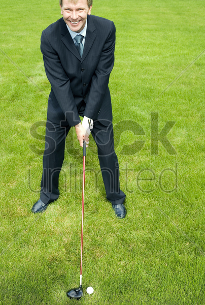 businessman playing golf stock photo