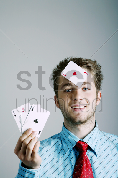 businessman playing with cards stock photo