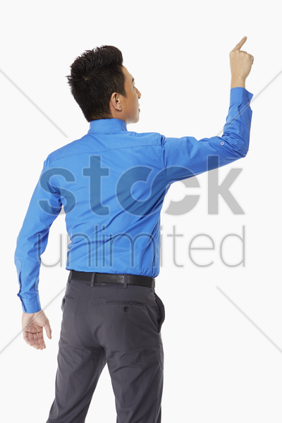 businessman pointing to one direction stock photo
