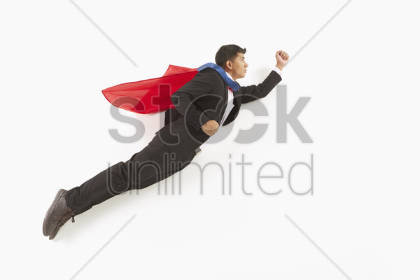 businessman posing on the floor, flying stock photo