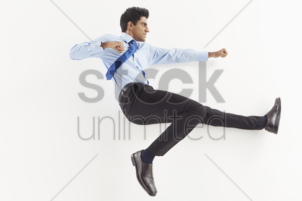 businessman posing on the floor, showing fighting gestures stock photo