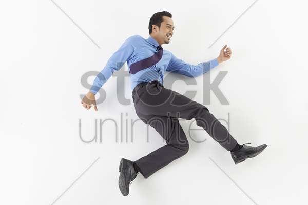 businessman posing on the floor stock photo