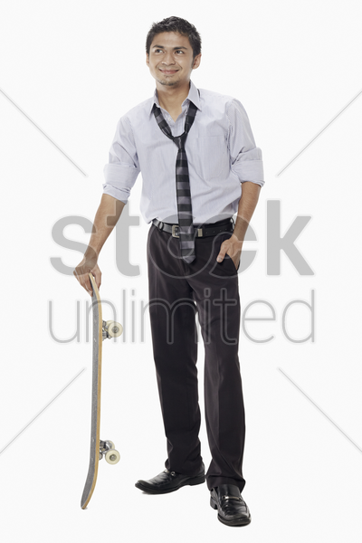 businessman posing with a skateboard stock photo