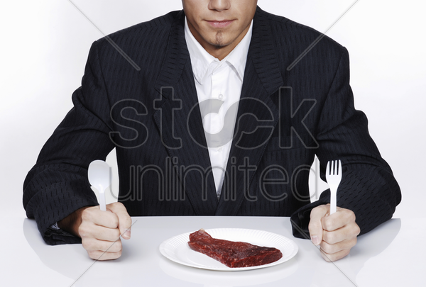 businessman preparing to eat his meal stock photo