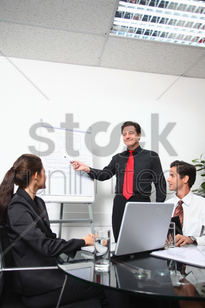 businessman presenting his ideas in a meeting stock photo
