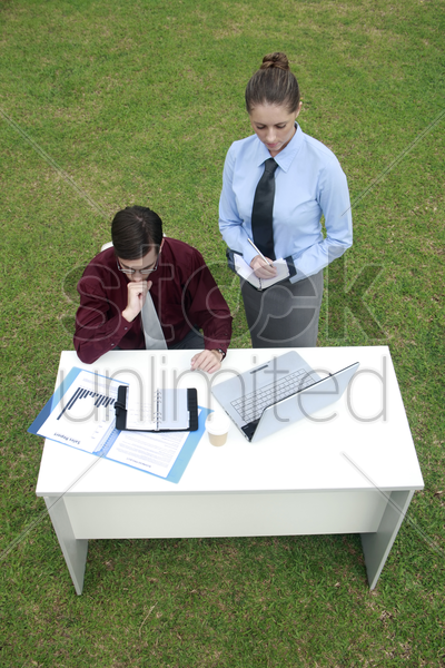 businessman reading document stock photo