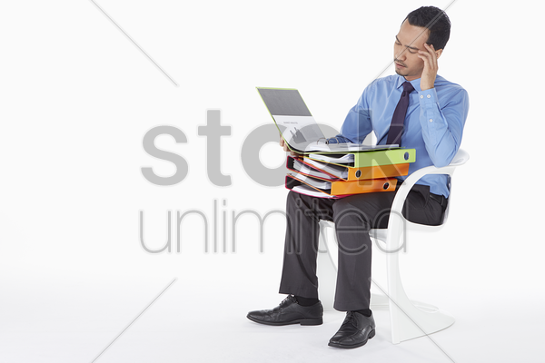 businessman reading documents in folder stock photo