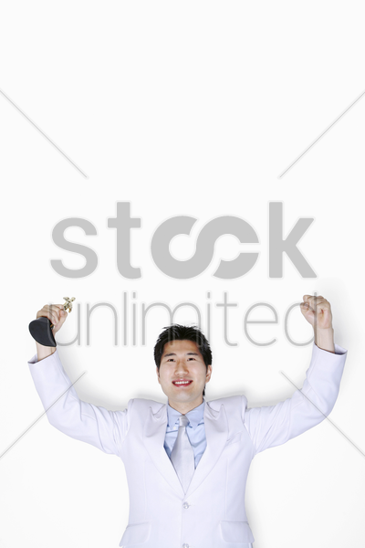 businessman rejoicing his success stock photo