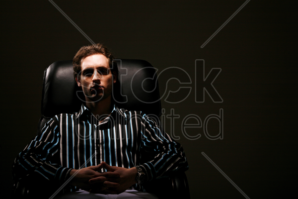 businessman relaxing on the chair stock photo