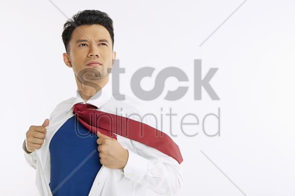 businessman ripping off his shirt stock photo