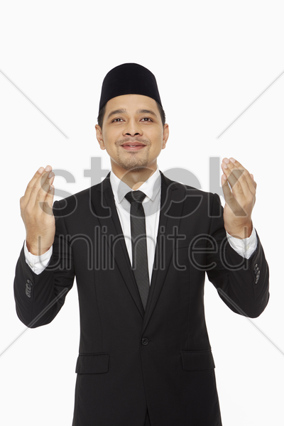 businessman saying a prayer stock photo