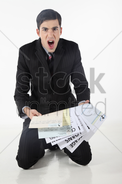 businessman shouting while looking at his loans stock photo