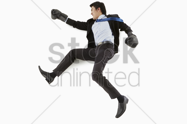 businessman showing a fighting gesture stock photo