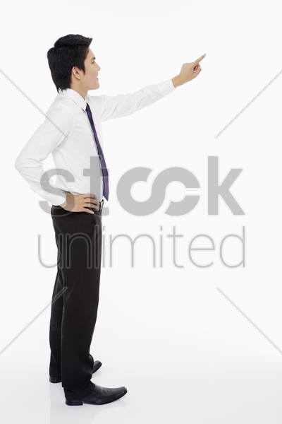 businessman showing a pointing gesture stock photo