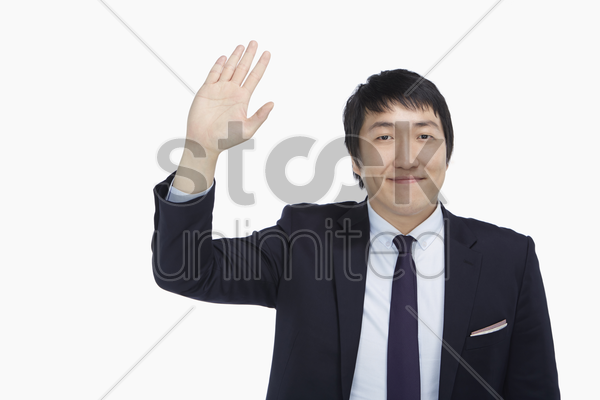 businessman showing a waving gesture stock photo