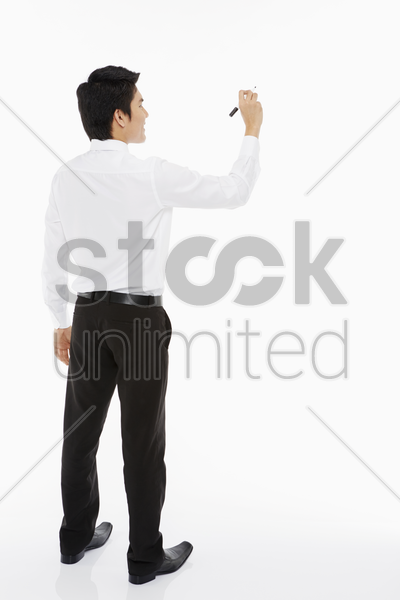 businessman showing a writing gesture stock photo