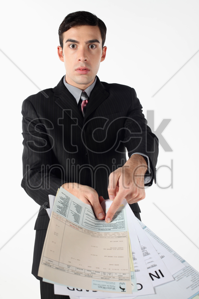 businessman showing all his loans stock photo