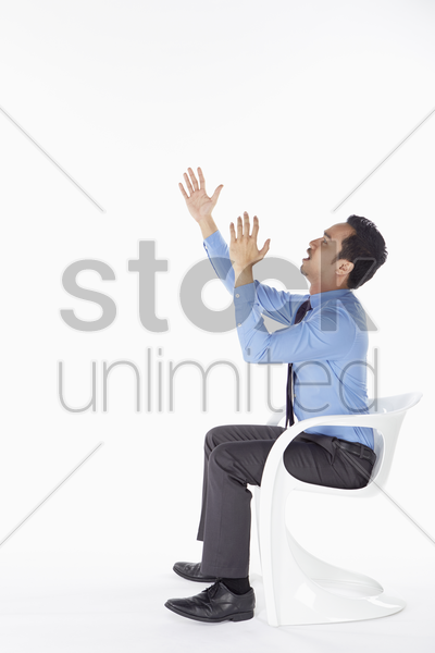 businessman showing an angry gesture stock photo
