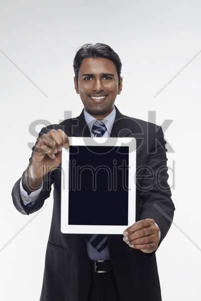 businessman showing digital tablet stock photo