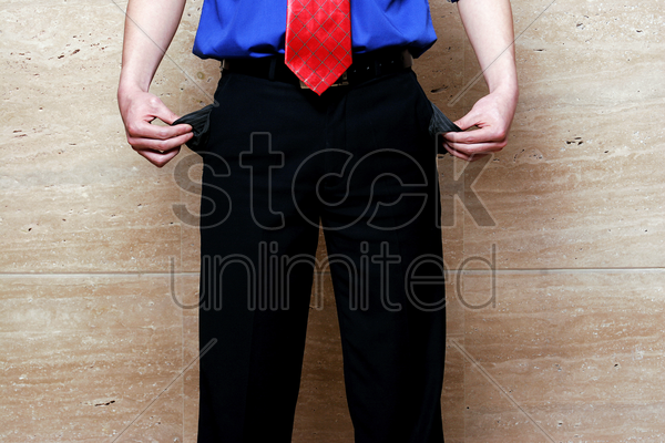 businessman showing empty pockets stock photo