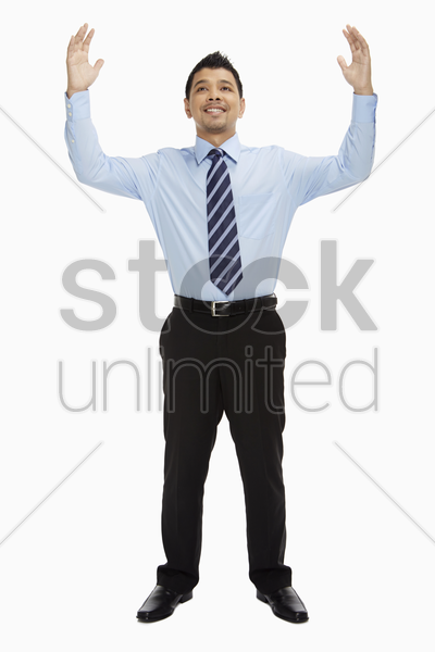 businessman showing hand gesture stock photo