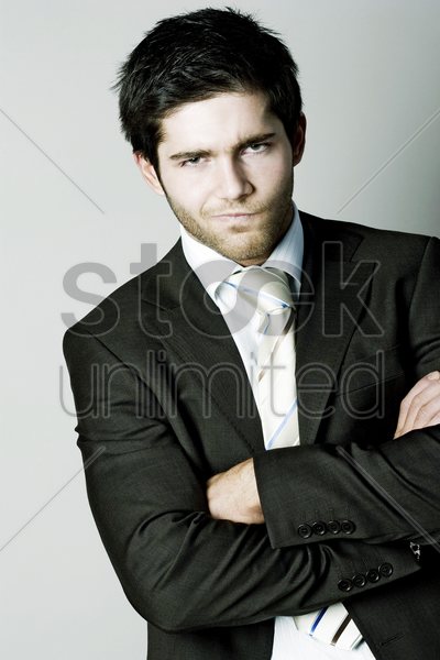 businessman showing his dissatisfied look stock photo