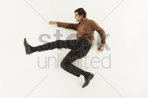 businessman showing punching and kicking gesture stock photo