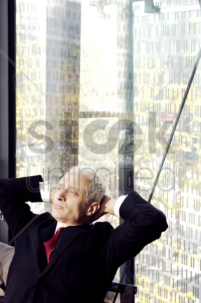 businessman sitting and thinking stock photo