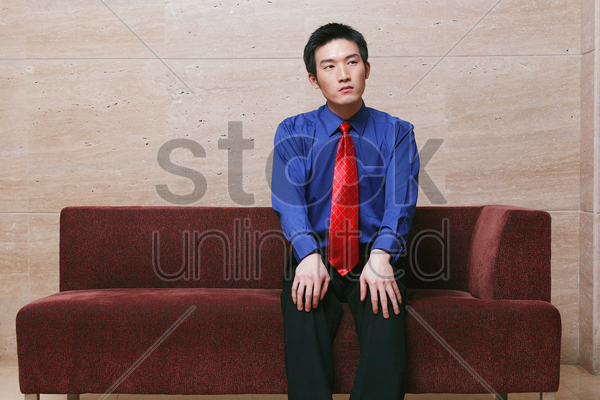 businessman sitting on couch stock photo
