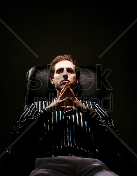 businessman sitting on the chair thinking stock photo