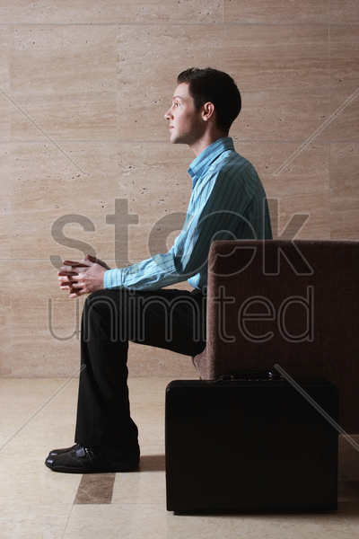 businessman sitting on the couch stock photo