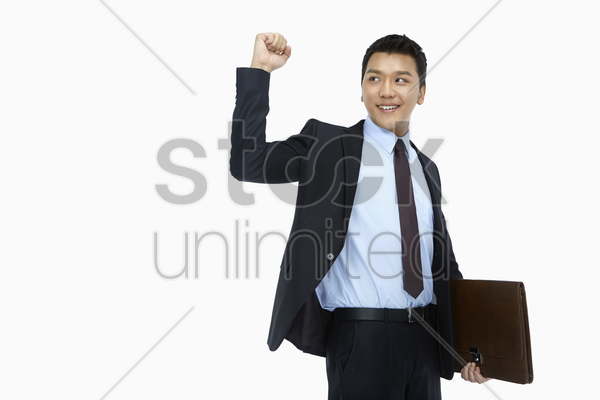 businessman smiling and cheering stock photo