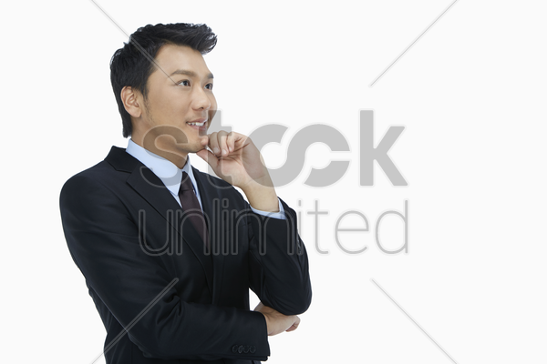 businessman smiling and contemplating stock photo